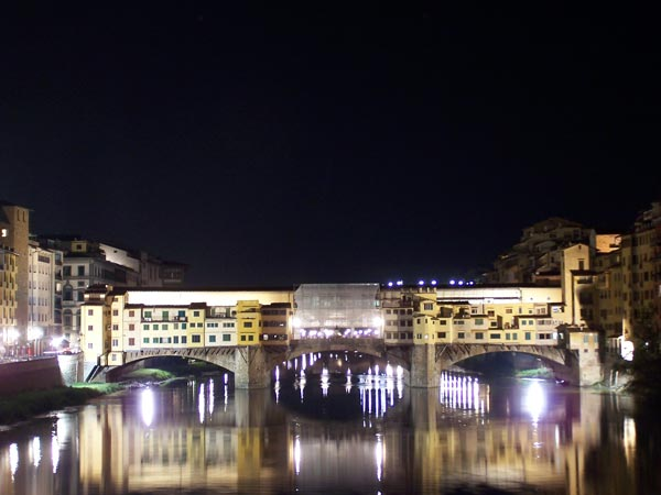 Ponte Vecchio bridge illuminated at night
